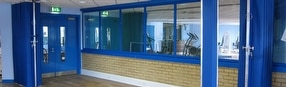 Fabric Concertina Partitioning System by Building Additions Ltd.